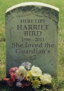An image of a gravestone reading: Here lies Harriet Bird 1986 - 2011 She loved the Guardian's g2